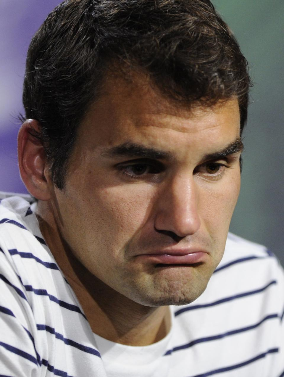 Roger Federer of Switzerland grimaces during a press conference after his defeat to Sergiy Stakhovsky of Ukraine in a Men's second round singles match at the All England Lawn Tennis Championships, Wimbledon, London, Wednesday, June 26, 2013. (AP Photo/AELTC, Thomas Lovelock)