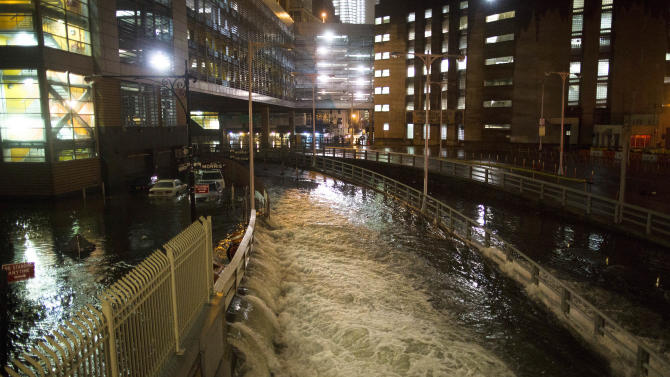FILE - In this Monday, Oct. 29, 2012 file photo, seawater floods the entrance to the Brooklyn Battery Tunnel in New York in the wake of Superstorm Sandy. More than three decades before Sandy, a state law and a series of legislative reports began warning New York politicians to prepare for a storm of historic proportions, spelling out scenarios eerily similar to what actually happened. (AP Photo/ John Minchillo, File)