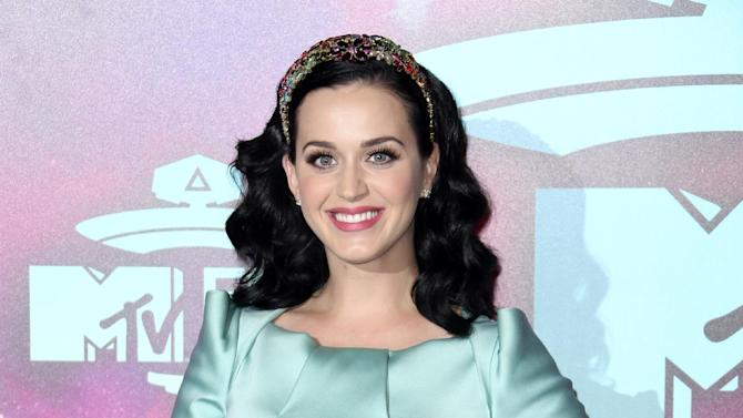 FILE - In this Nov. 10, 2013 file photo, U.S. singer Katy Perry poses at the 2013 MTV Europe Music Awards, in Amsterdam, Netherlands. Perry is launching her own record label. She announced the launch of Metamorphosis Music on Tuesday, June 17, 2014. It's a joint venture with the singer's current label, Capitol Records. (Photo by Joel Ryan/Invision/AP, File)