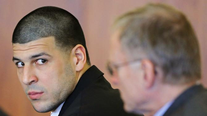 Former New England Patriots tight end Aaron Hernandez attends a pre-trial hearing in Fall River