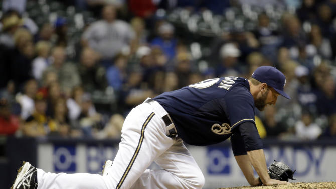 Milwaukee Brewers relief pitcher Jim Henderson reacts after hurting his leg during the ninth inning of a baseball game against the Pittsburgh Pirates, Friday, May 24, 2013, in Milwaukee. (AP Photo/Morry Gash)