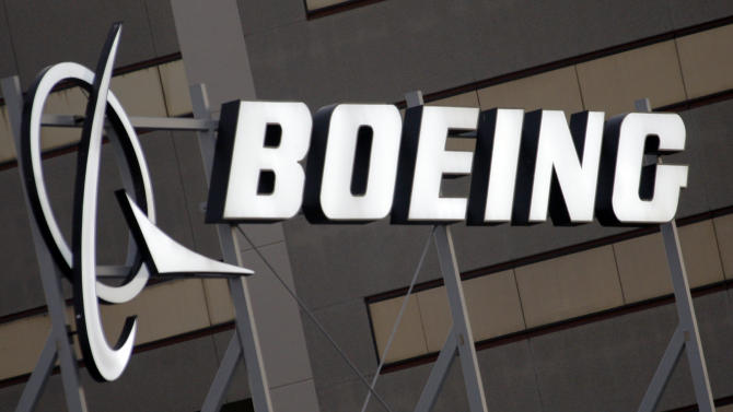 FILE - This Jan. 25, 2011, file photo, shows the Boeing Company logo on the property in El Segundo, Calif. Boeing Co. said Wednesday, April 25, 2012, that its first-quarter earnings jumped 58 percent on higher revenue from sales of commercial airplanes, helping it overcome slow growth in its defense business. The company also raised its 2012 profit forecast. (AP Photo/Reed Saxon, File)