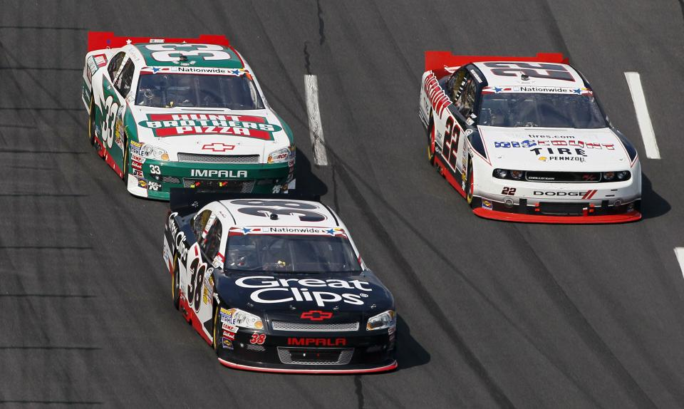 Kevin Harvick (33) and Brad Keselowski (22) chase leader Kasey Kahne (38) during the NASCAR Nationwide Series History 300 auto race in Concord, N.C., Saturday, May 26, 2012. (AP Photo/Gerry Broome)
