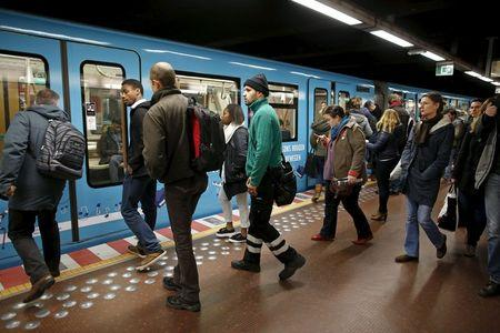People prepare to board a subway train at the Central Station stop in Brussels