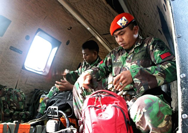 Indonesian Air Force jumper prepare their gear before departing on a rescue mission to the site where a Russian-made Sukhoi Superjet-100 plane crashed, at their base in Pasir Pogor, West Java, Indones