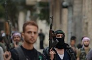 Syrian opposition fighters walk in the northern Syrian city of Aleppo. The war of words between Syria and Turkey escalated on Thursday when Ankara said it had found military supplies on a passenger plane it intercepted en route between Moscow and Damascus