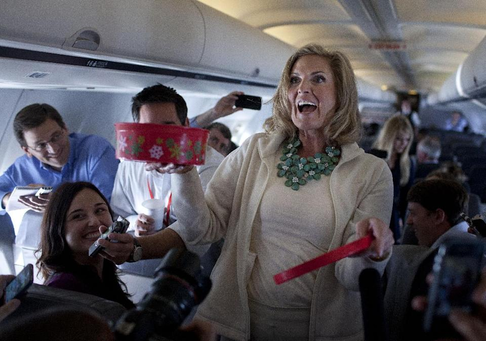 Ann Romney, wife of Republican presidential candidate, former Massachusetts Gov. Mitt Romney hands out cookies during a flight to Tampa, Tuesday, Aug. 28, 2012.  (AP Photo/Evan Vucci)