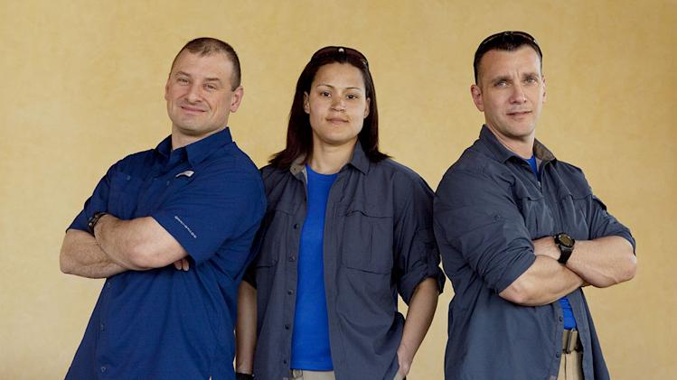 "The Cops:  Robert Robillard, Dani Henderson, and Jim Vaglica compete in ""Expedition Impossible."""