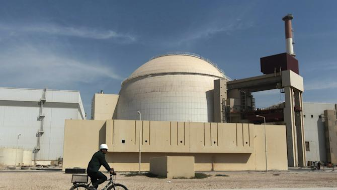 FILE - In this Oct. 26, 2010 file photo, a worker rides a bicycle in front of the reactor building of the Bushehr nuclear power plant, just outside the southern city of Bushehr, Iran. Israel has led the speculation that Iran could be moving closer to having all the pieces ready for a nuclear weapon. Israel also fears the negotiations could leave intact the mainstays of Iran's nuclear network: The ability to enrich uranium and produce atomic fuel. (AP Photo/Mehr News Agency, Majid Asgaripour, File)