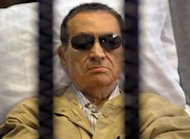 Ousted Egyptian president Hosni Mubarak sits inside a cage in a courtroom during his verdict hearing in Cairo on June 2. Mubarak, now serving a life sentence in a Cairo prison over the killing or protesters, said the authorities &quot;want to kill&quot; him in jail