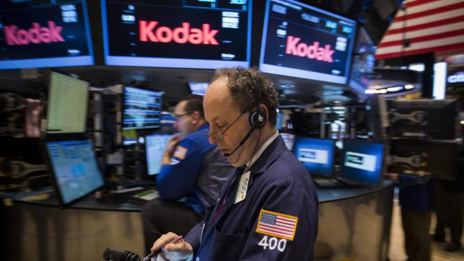A trader works on the floor of the New York Stock Exchange in the Manhattan borough of New York