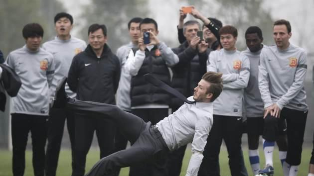 David Beckham falls during his visit to Wuhan Zall Football club on March 23, 2013 in Wuhan, Hubei Province of China -- Getty Premium