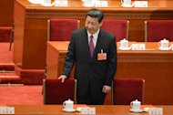 "Newly-elected China's President, Xi Jinping, takes his seat at the closing session of the National People's Congress (NPC), at the Great Hall of the People in Beijing, on March 17, 2013. Xi said he would fight for a ""great renaissance of the Chinese nation"", in his first speech as head of state of the world's most populous country, without giving a detailed account of the phrase's meaning"