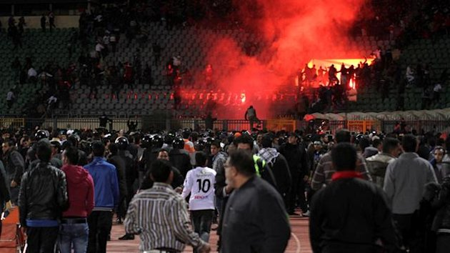 Soccer fans flee from a fire at Port Said Stadium February 1, 2012. Seventy-three people were killed and at least 1,000 injured on Wednesday after a soccer pitch invasion in the Egyptian city of Port Said, a health ministry official said, in an incident t