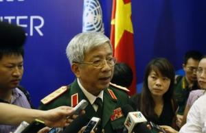 Vietnam's Deputy Defence Minister General Nguyen Chi Vinh speaks with media after the inauguration ceremony of Vietnam Peace Keeping Center in Hanoi