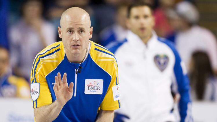 Team Alberta's skip Kevin Koe guides a rock in the first end against team British Columbia during the championship draw at the 2014 Tim Hortons Brier curling championships in Kamloops.