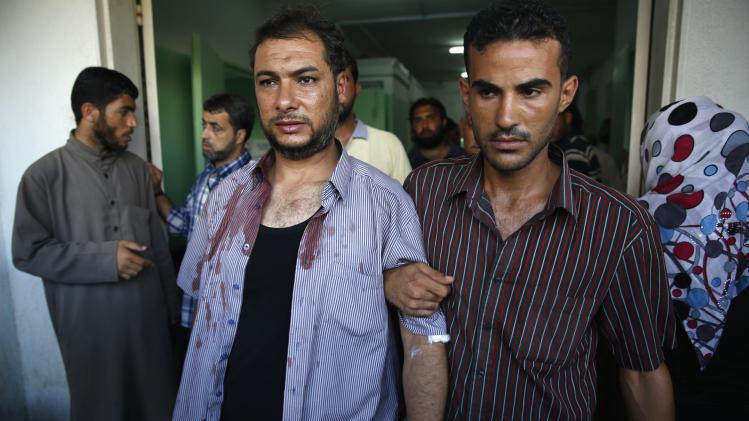 A Palestinian man, whom medics said was wounded by Israeli shelling, is treated at a hospital at Beit Lahiya in the northern Gaza Strip