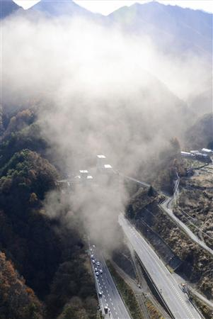 Smoke is seen from the Sasago Tunnel on the Chuo Expressway in Koshu
