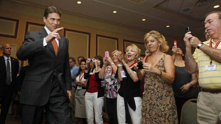 Texas Gov. Rick Perry arrives to speak at the RedState Gathering, a meeting of conservative activists, where he announced his run for president in Charleston, S.C., Saturday, Aug. 13, 2011. (AP Photo/Gerry Broome)