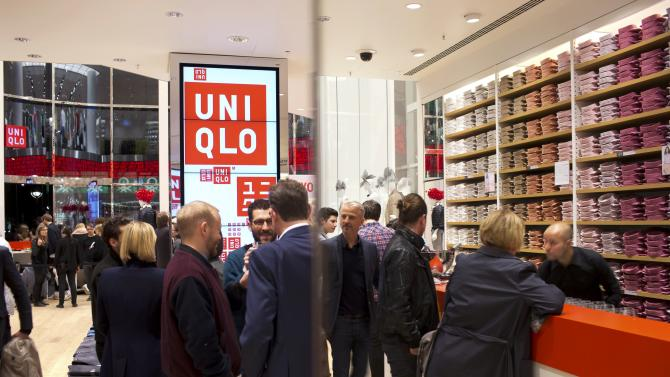 People visit the Uniqlo Global flagship store during a preopening in Berlin