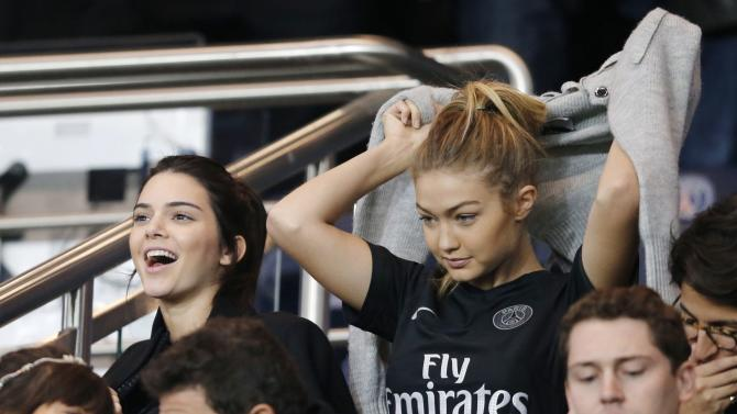 US models Kendall Jenner and Gigi Hadid attend the French league soccer between Paris St Germain and Olympique Marseille at the Parc des Princes stadium in Paris