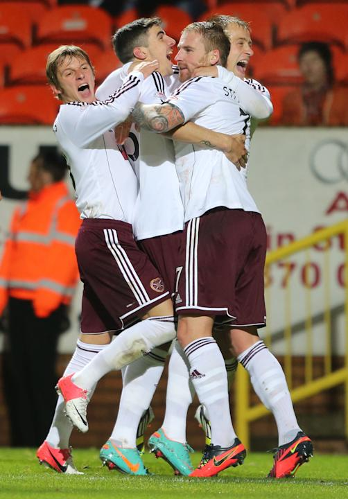 Callum Paterson's, centre, goal gave Hearts the early lead but Dundee United fought back to take it to extra time and penalties