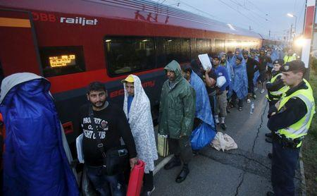 Migrants arrive at the Austrian train station of Nickelsdorf to board trains to Germany