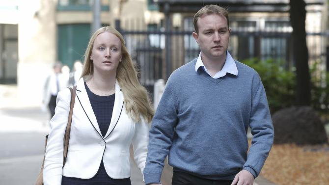 Former trader Tom Hayes and his wife Sarah arrive at Southwark Crown Court in London.