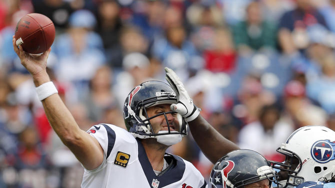 Houston Texans quarterback Matt Schaub (8) gets a pass away as center Chris Myers (55) blocks Tennessee Titans defensive tackle Sen'Derrick Marks, right, in the first quarter of an NFL football game on Sunday, Dec. 2, 2012, in Nashville, Tenn. (AP Photo/Joe Howell)