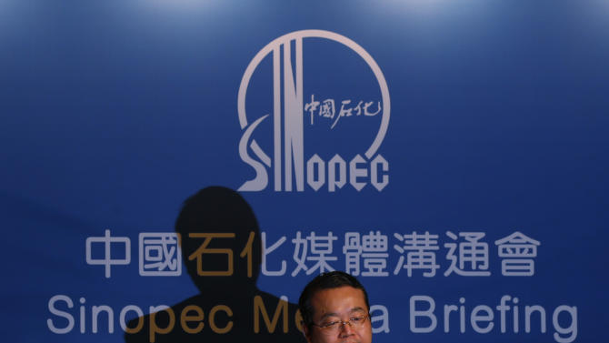 Sinopec representative, Vice President of Sinopec Chemical Commercial Holdings Company Ltd. Zhang Guoming attends a press conference in Hong Kong Thursday Aug. 9, 2012. Chinese oil company Sinopec, Thursday, is promising to clean up millions of its tiny plastic pellets that washed up on beaches across Hong Kong after they fell off a ship during a strong typhoon. (AP Photo/Kin Cheung)