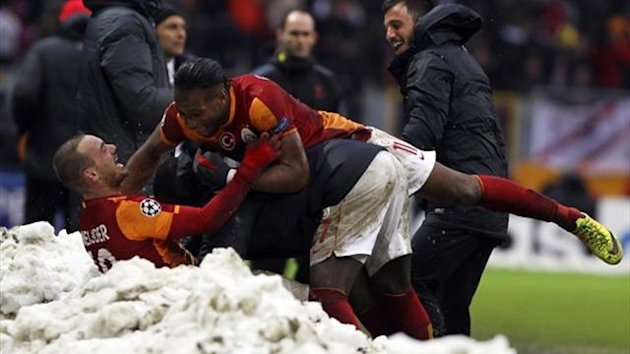 Galatasaray's Wesley Sneijder (bottom) celebrates with his team mate Didier Drogba (Reuters)