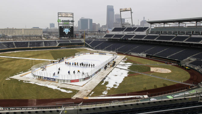 Omaha's junior hockey team, the Omaha Lancers, practice on the outdoor surface at TD Ameritrade Park in Omaha, Neb., Thursday, Feb. 7, 2013, where on Saturday the Nebraska-Omaha Mavericks will play North Dakota in a college hockey game. The rink sits between what would be first and third bases at the baseball stadium where the College World Series is played each June. (AP Photo/Nati Harnik)