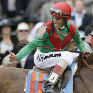 John Velazquez reacts after riding Animal Kingdom to victory during the 137th Kentucky Derby horse race at Churchill Downs Saturday, May 7, 2011, in Louisville, Ky. (AP Photo/David J. Phillip)
