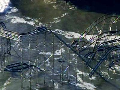 Raw: Sandy throws roller coaster into the ocean