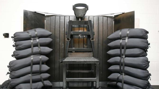 FILE - In this June 18, 2010, file photo, the firing squad execution chamber at the Utah State Prison in Draper, Utah, is shown. With lethal-injection drugs in short supply and new questions looming about their effectiveness, lawmakers in some death penalty states are considering bringing back relics of a more gruesome past, including firing squads. (AP Photo/Trent Nelson, Pool, File)