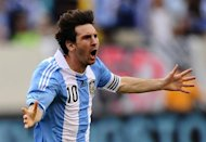 Argentinian soccer player Lionel Messi celebrates after scoring his third goal during a friendly match against Brazil at the MetLife Stadium in East Rutherford, New Jersey, on June 9, 2012. Argentina won 4-3.    AFP PHOTO/Mehdi Taamallah