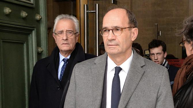 French former minister Eric Woerth and his lawyer Jean-Yves Le Borgne (L) leave the courthouse of Bordeaux, southwestern France, on February 20, 2015