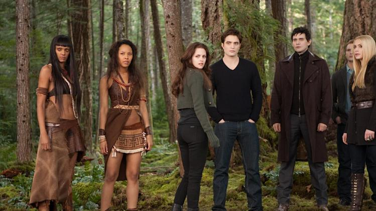 "FILE- This undated file photo provided by Summit Entertainment shows, from left, Judith Shekoni, Tracey Heggins, Kristen Stewart, Robert Pattinson, Christian Camargo, Peter Facinelli and Casey LaBow in a scene from the film ""The Twilight Saga: Breaking Dawn - Part 2."" The finale to the blockbuster supernatural romance dominated the 33rd Annual Razzie Awards on Saturday, Feb. 23, 2013 with seven awards, including worst actress for Kristen Stewart, supporting actor for Taylor Lautner, director for Bill Condon and worst screen couple for Lautner and child co-star Mackenzie Foy. (AP Photo/Summit Entertainment, Andrew Cooper, SMPSP, File)"