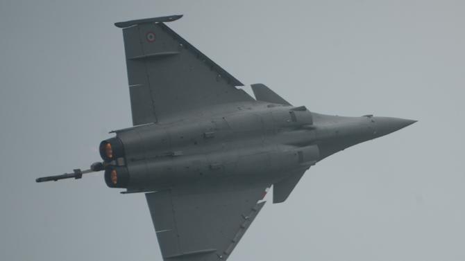Pilot Benoit Flanche performs a manoeuvre in his Dassault Rafale aircraft during a demonstration flight at Halim airport in Jakarta on March 25, 2015