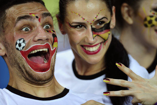 German fans cheer prior to the the Euro 2012 soccer championship Group B match between the Netherlands and Germany in Kharkiv, Ukraine, Wednesday, June 13, 2012. (AP Photo/Manu Fernandez)