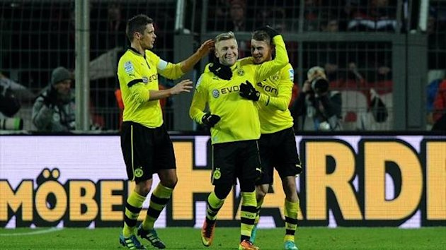 Jakub Blaszczykowski celebrates with team-mates (Imago)