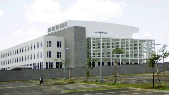 """CAPTION CORRECTS REMOVES NUMBER OF PEOPLE KILLED IN FIRST SENTENCEFILE - In this file photo of Monday, March 3, 2003, A new U.S. Embassy on the outskirts of Nairobi. The largest U.S. diplomatic mission in sub-Saharan Africa replaces the earlier mission that was destroyed by a terrorist bomb on Aug, 7, 1998, killing over 200 people. As President Barack Obama prepares to visit East Africa nearly 15 years after terrorists bombed two U.S. embassies here, a former United States ambassador to Kenya says he worries that security at the Nairobi embassy has been """"complacent"""" and may not have had adequate priority in the recent past. Obama is scheduled on Monday, July 1, 2013, to visit Dar es Salaam, the commercial capital of Tanzania, which along with Nairobi was the site of near-simultaneous embassy attacks in August 1998. The attacks killed 224 people, mostly Kenyans, but also a dozen Americans. Obama is likely to visit the memorial for the victims of the Tanzania attack. (AP Photo/Khalil Senosi, File)"""