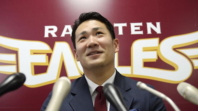 FILE - In this Dec. 17, 2013 file photo, Rakuten Golden Eagles pitcher Masahiro Tanaka speaks at a press conference after a meeting with his club president, in Sendai, northern Japan. Tanaka's team says it has decided to let him seek his career in Major League baseball next season, reversing its earlier rejection. Rakuten Eagles president Yozo Tachibana told a news conference Wednesday, Dec. 25, 2013 that it has decided to release him through the posting system. (AP Photo/Kyodo News, File) JAPAN OUT, MANDATORY CREDIT
