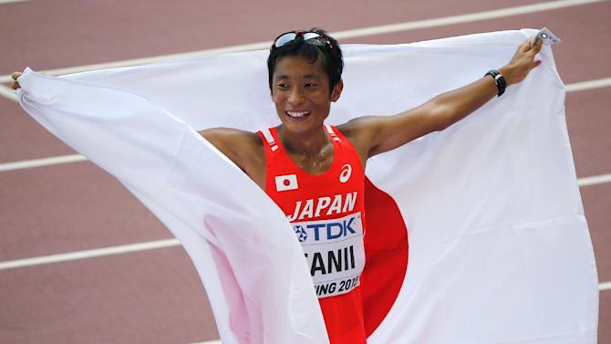 Japan's Takayuki Tanii celebrates finishing third in the men's 50km race walk final at the World Athletics Championships at the Bird's Nest stadium in Beijing, Saturday, Aug. 29, 2015. (AP Photo/Mark Schiefelbein)