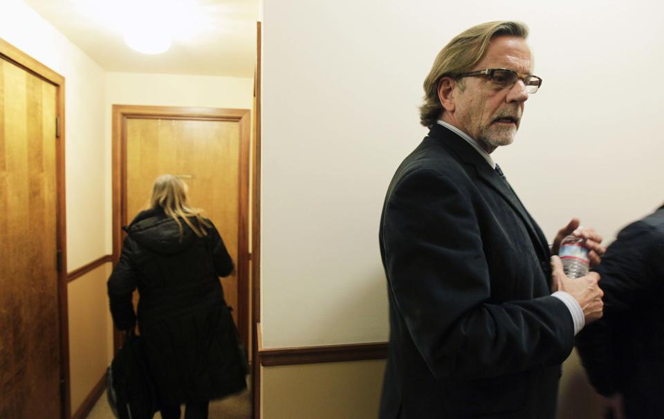 Attorney John Henry Browne, right, talks to reporters in a hallway outside his law office, Thursday, March 15, 2012, in Seattle. Browne will be representing the U.S. soldier accused of killing 16 Afghan civilians. (AP Photo/Ted S. Warren)