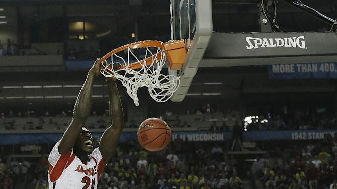 Louisville forward Montrezl Harrell (24) dunks the ball against Michigan forward Glenn Robinson III (1) during the first half of the NCAA Final Four tournament college basketball championship game Monday, April 8, 2013, in Atlanta. (AP Photo/Charlie Neibergall)