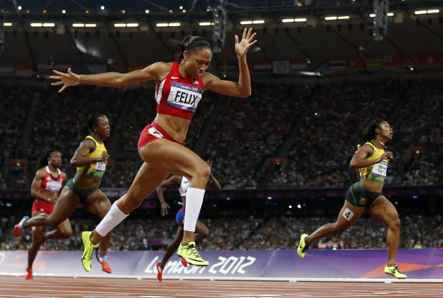 United States' Allyson Felix, second from right, crosses the finish line to win gold ahead of Jamaica's Shelly-Ann Fraser-Pryce, right, in the women's 200-meter final during the athletics in the Olympic Stadium at the 2012 Summer Olympics, London, Wednesday, Aug. 8, 2012. (AP Photo/Matt Dunham)