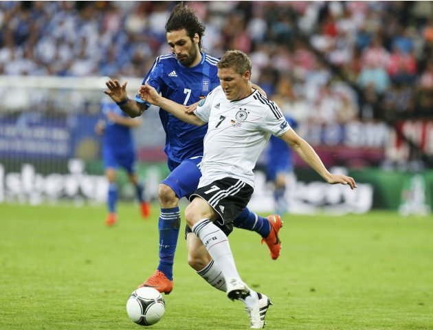 Germany's Schweinsteiger challenges Greece's Samaras during  their Euro 2012 quarter-final soccer match at the PGE Arena in Gdansk