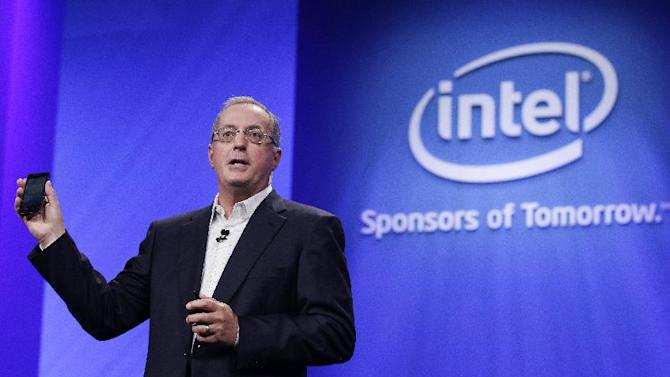 FILE - In this Tuesday, Sept. 13, 2011.Intel CEO Paul Otellini, holds up a Google Android phone running on an Intel chip during the keynote address at the Intel Developer Forum in San Francisco. Intel said Thursday, May 2, 2013, that it has chosen Brian Krzanich, as its new CEO. Krzanich, who is 52, will replace Otellini on May 16, at the company's annual meeting. Otellini had announced his decision to resign in November. Otellini, 62, will be ending a nearly 40-year career with Intel, including an eight-year stint as CEO by the time he leaves. (AP Photo/Paul Sakuma)