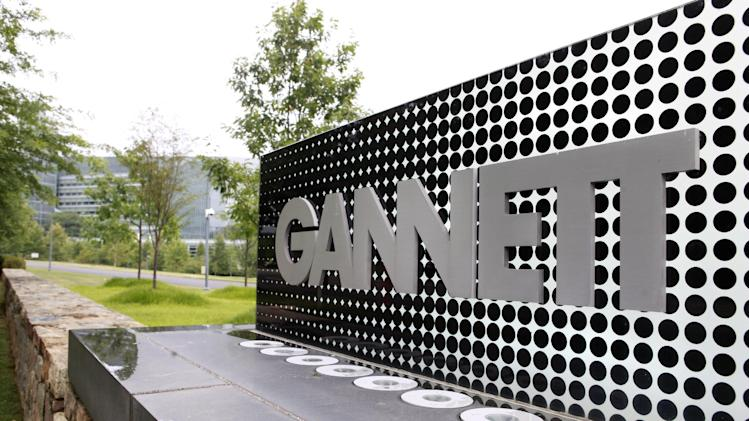 FILE - In this July 14, 2010 file photo, a sign for Gannett headquarters is displayed in McLean, Va. Gannett Co. reported higher net income and revenue on Monday, Oct. 15, 2012, helped by strong gains in political and Olympics-related advertising. (AP Photo/Jacquelyn Martin, file)